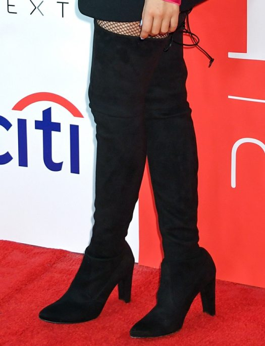 Camila Cabello teams her blazer dress with black fishnets and thigh-high boots