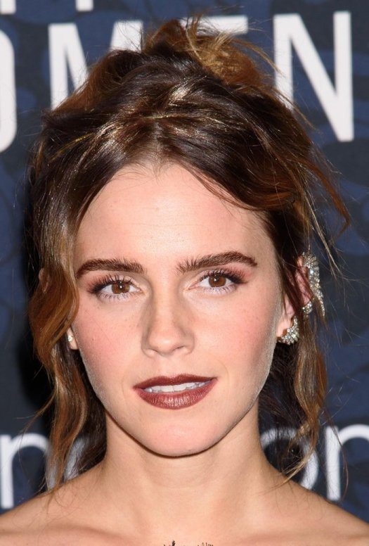 Emma Watson with a tousled hairstyle to show off her Fred Leighton diamond wing ear cuffs
