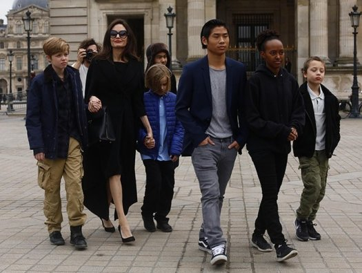 Angelina Jolie with her children Shiloh Pitt Jolie, Maddox Pitt Jolie, Vivienne Marcheline Pitt Jolie, Pax Thien Pitt Jolie, Zahara Marley Pitt Jolie, Knox Leon Pitt Jolie, visit the Louvre in Paris