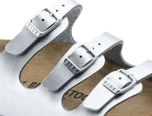 "The Birkenstock 'Florida' sandals have three small buckles that show the ""BIRK"" logo"