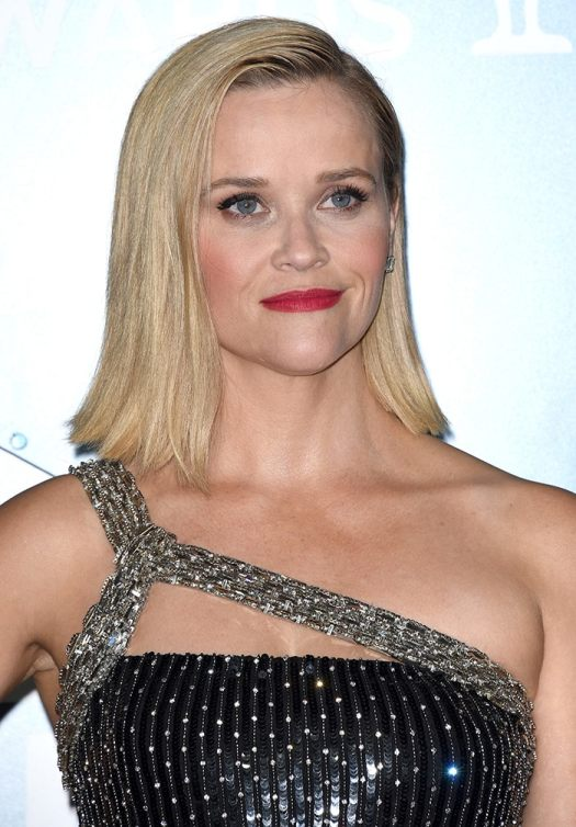 Reese Witherspoon wears side-swept straightened locks with red lipstick