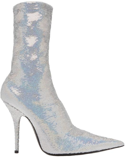 These Balenciaga boots are made with an exaggerated point toe and are shaped with a sock-like knitted body that hugs the ankle
