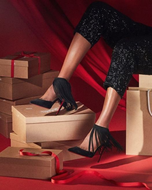 Long chain fringe adds dynamic movement to a pointy-toe stiletto pump that's destined to stand out from the crowd