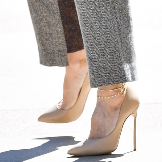 Heidi Klum shows off her feet in nude pointed stiletto pumps