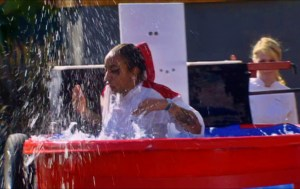 Alison gets dunked after a teammate incorrectly guesses an ingredient in the blind taste test challenge on Hell's Kitchen season 14.