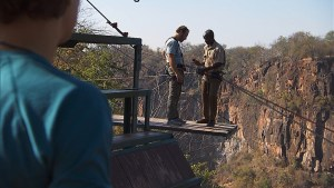 """""""King of the Jungle""""--In this Road Block, Chris (center) must freefall over 200 feet into Batoka Gorge then swing over the rapids of the Zambezi River on THE AMAZING RACE, Friday, Oct. 23 (8:00-9:00 PM, ET/PT) on the CBS Television Network. Photo: CBS ©2015 CBS Broadcasting, Inc. All Rights Reserved"""