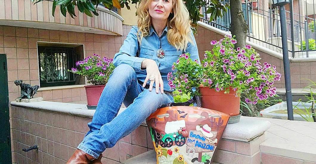 jeans e borsa braccialini