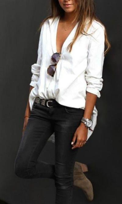 white blouse and denim pants