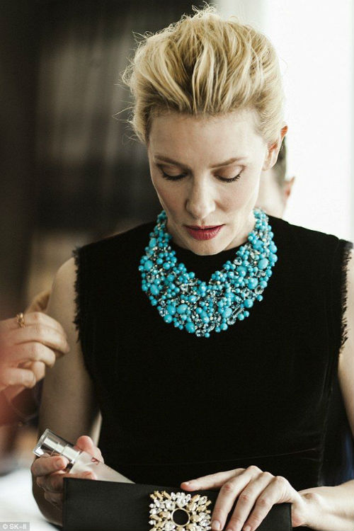 turquoise necklace on a black top, Pinterest