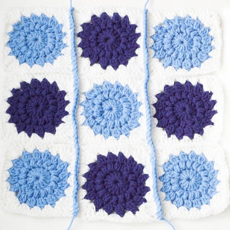 Crocheted Sunburst Pillow   YouShouldCraft.com
