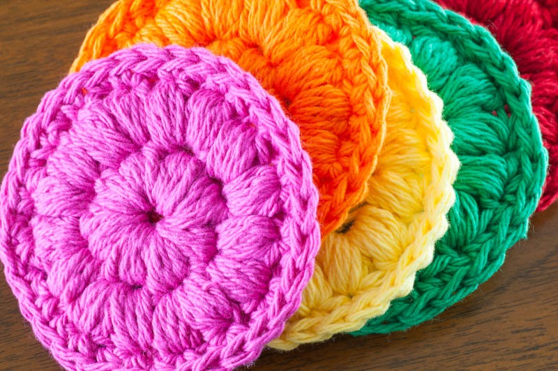 pile of brightly colored cotton face scrubbies
