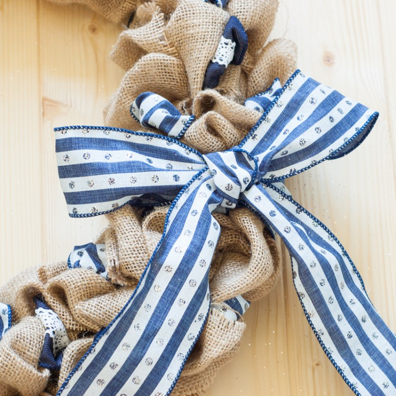 Decorate your front door DIY-style, with a burlap and ribbon wreath. Perfect for summer or any season! Photo tutorial from YouShouldCraft.com