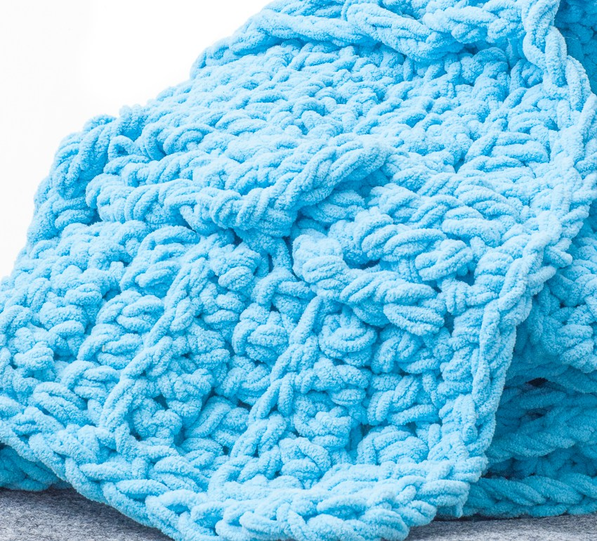 #Crochet a chunky throw with braids and twisted cables. This free crochet pattern uses two strands of Bernat blanket yarn to create a squishy, snuggly blanket.