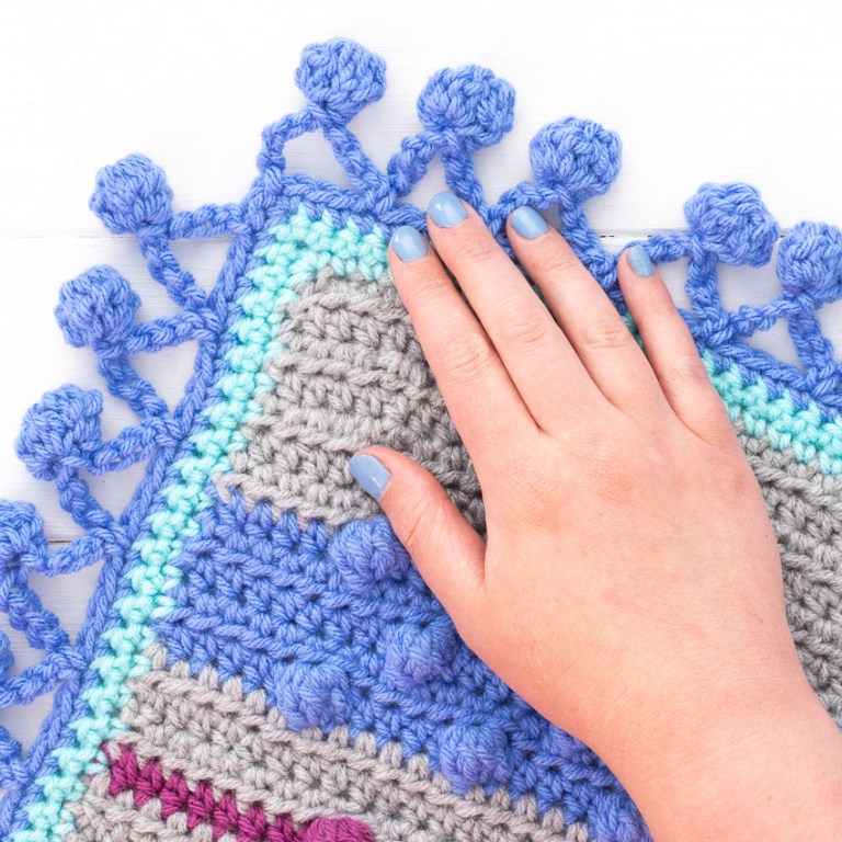 bobble blanket with human hand on a white background