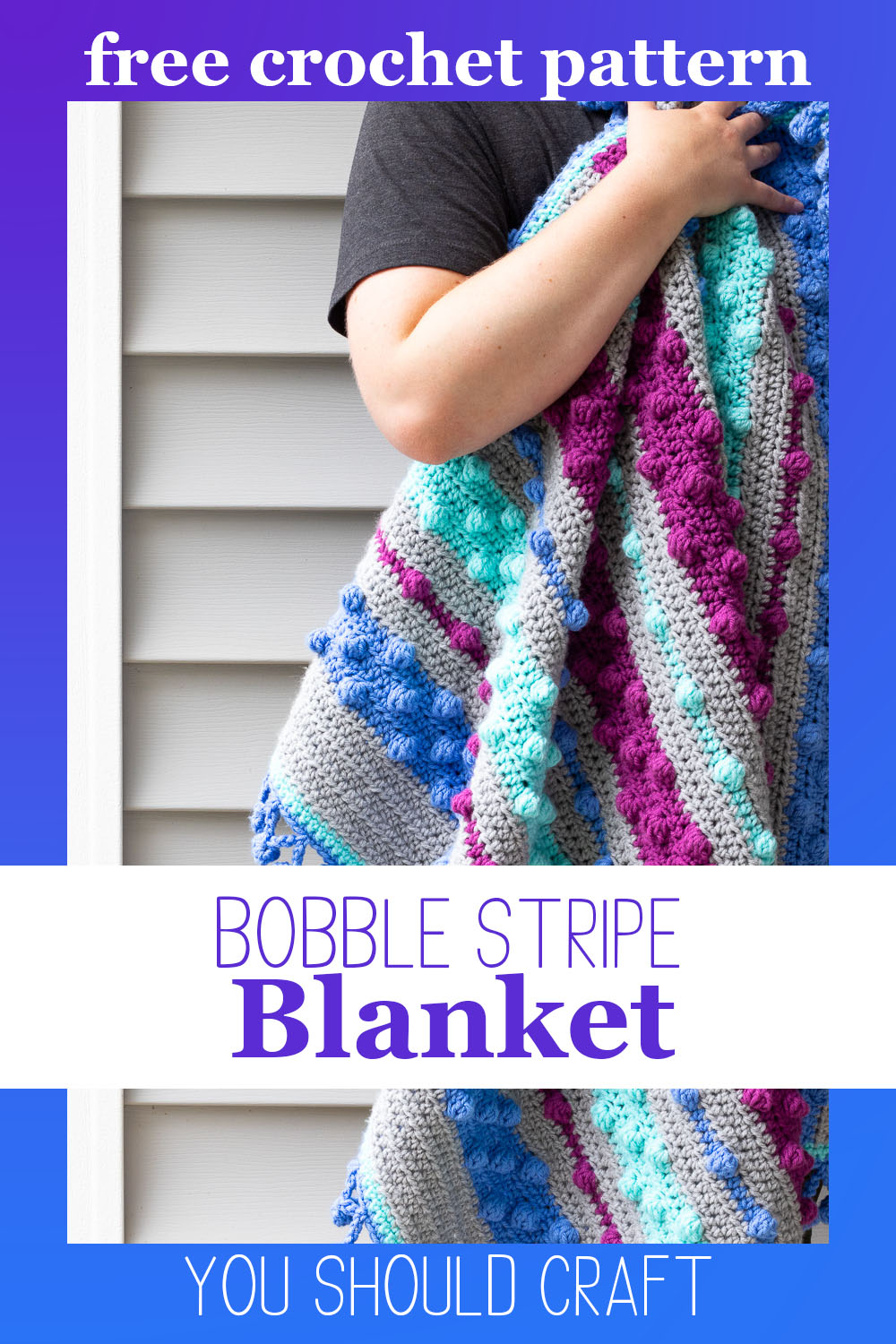 "arm holding crochet bobble stripe blanket with text reading ""bobble stripe blanket - free crochet pattern from you should craft"""