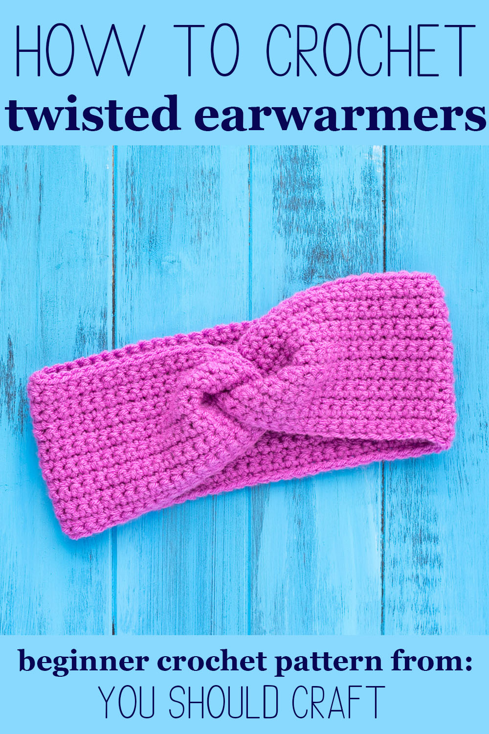 "purple twisted ear warmer on a blue wooden background with text ""how to crochet twisted ear warmers - beginner crochet pattern from you should craft"""