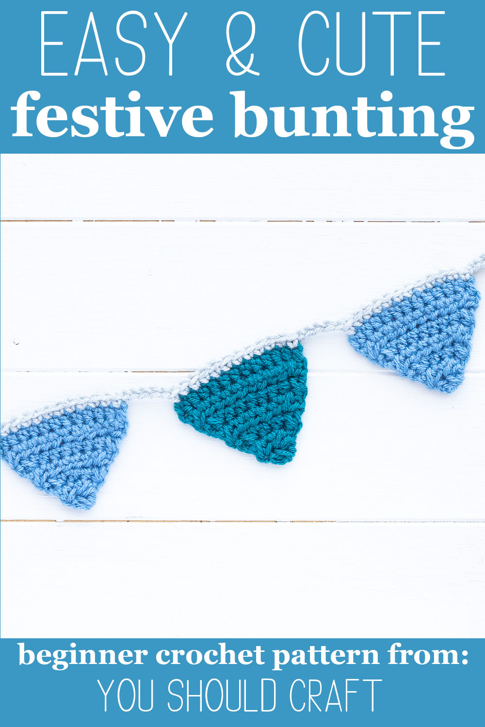 """blue crocheted bunting on a white wooden background with text """"easy & cute festive bunting - beginner crochet pattern from: you should craft"""""""