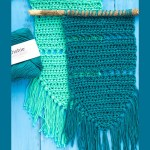 "two green and teal crocheted items with text ""simple fringed wall hanging - you should craft"""