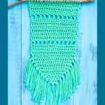 "green crocheted item with text ""simple fringed wall hanging - you should craft"""