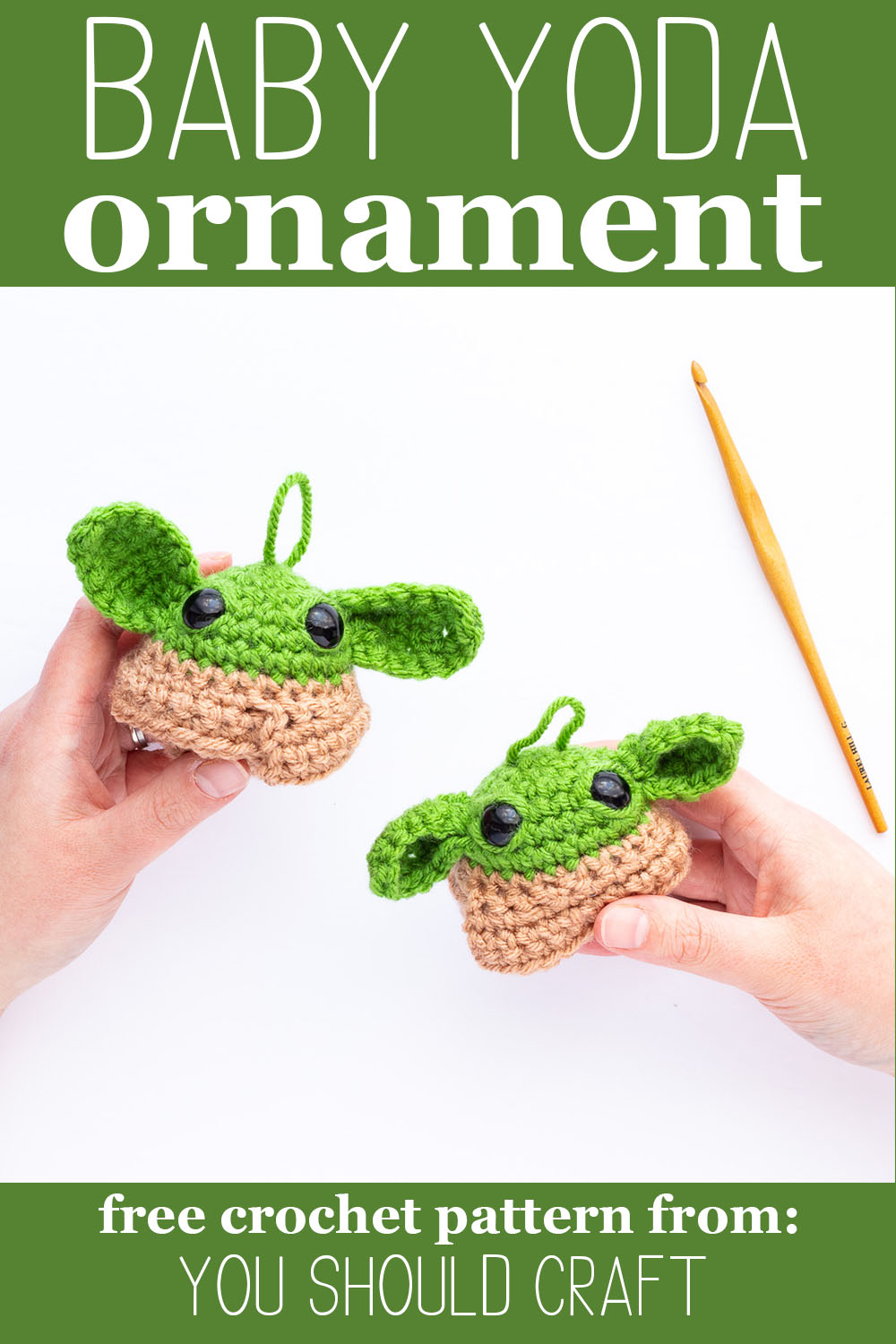 "two hands holding two crocheted grogu balls on a white background with text ""baby yoda ornament - free crochet pattern by you should craft"""