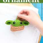"hand holding grogu on a white towel with text ""baby yoda ornament - free crochet pattern from you should craft"""