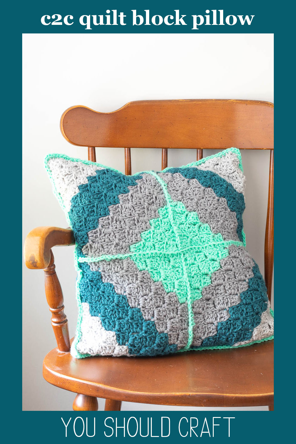 """diamond crochet pillow on a wooden chair with text """"c2c quilt block pillow - you should craft"""""""