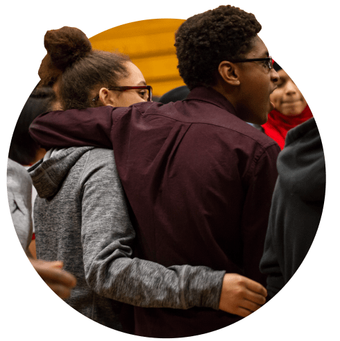 students arm in arm on a respect retreat