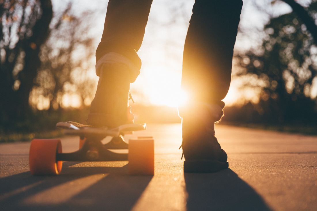 teenage fun — skateboarding at sunset