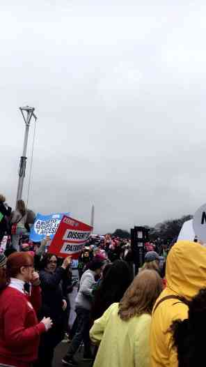 A distant view of the Washington in a sea of protesters.