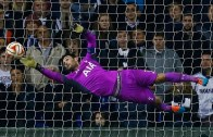 Tottenham Hotspur's goalkeeper Hugo Lloris makes a save in the last few minutes of the Europa League soccer match against Partizan Belgrade at White Hart Lane in London