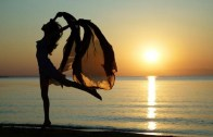 beautiful-woman-beach-flying-d