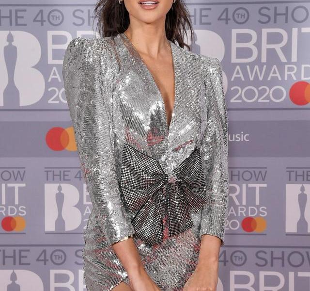 Michelle Keegan (Michelle Keegan) wearing a silver sequined skirt attended the event. The star made headlines. Celebrity fashion Portrait photography.