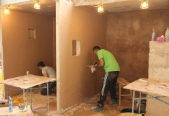Skim a wall with plaster