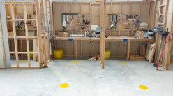 Perspex between carpentry & joinery bays and yellow dots 2m spacing on floor