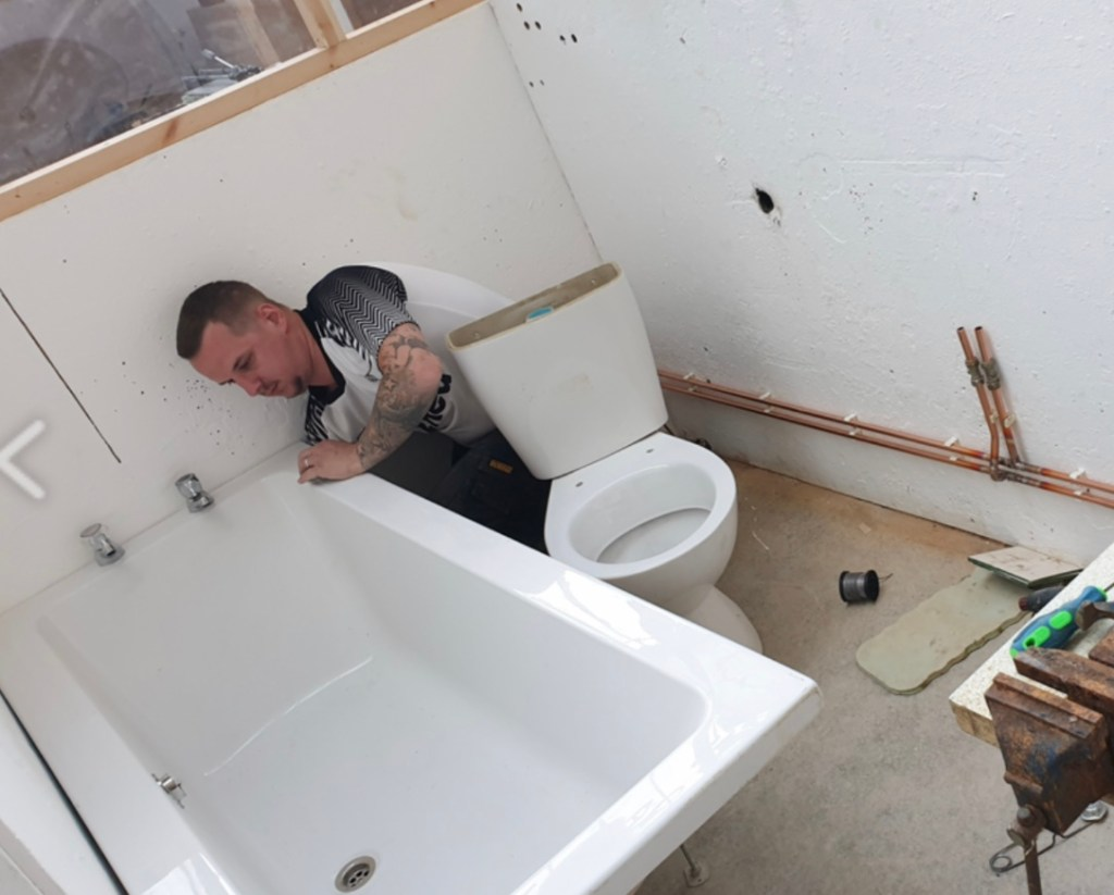 Lee Elliott completing the plumbing course