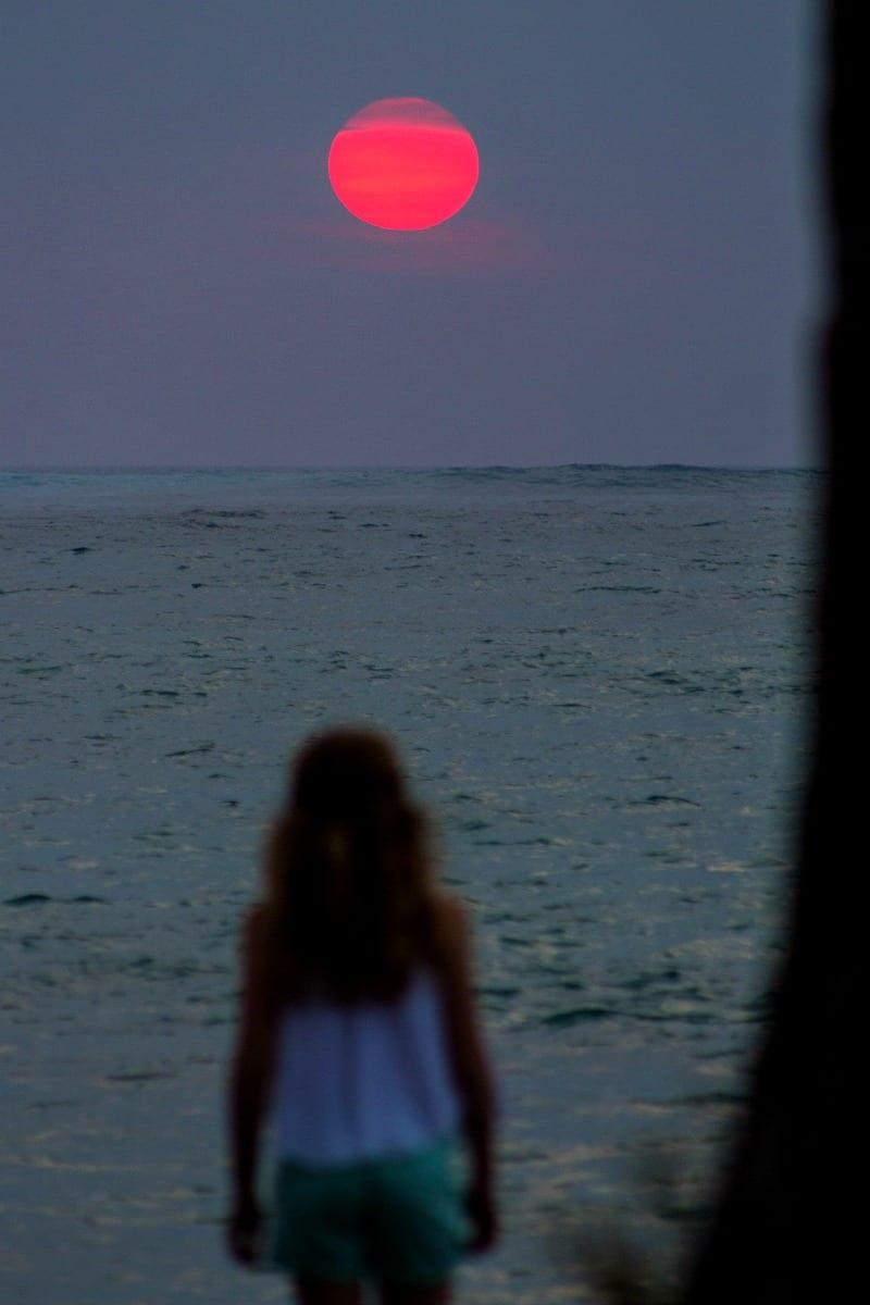Watch the sunset at Lava Lava Beach Club in Waikaloa on the Big Island of Hawaii