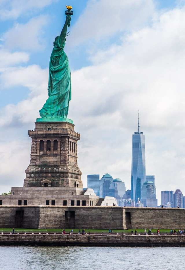 Statue of Liberty and Freedom Tower in New York City. See this on a Statue of Liberty tour