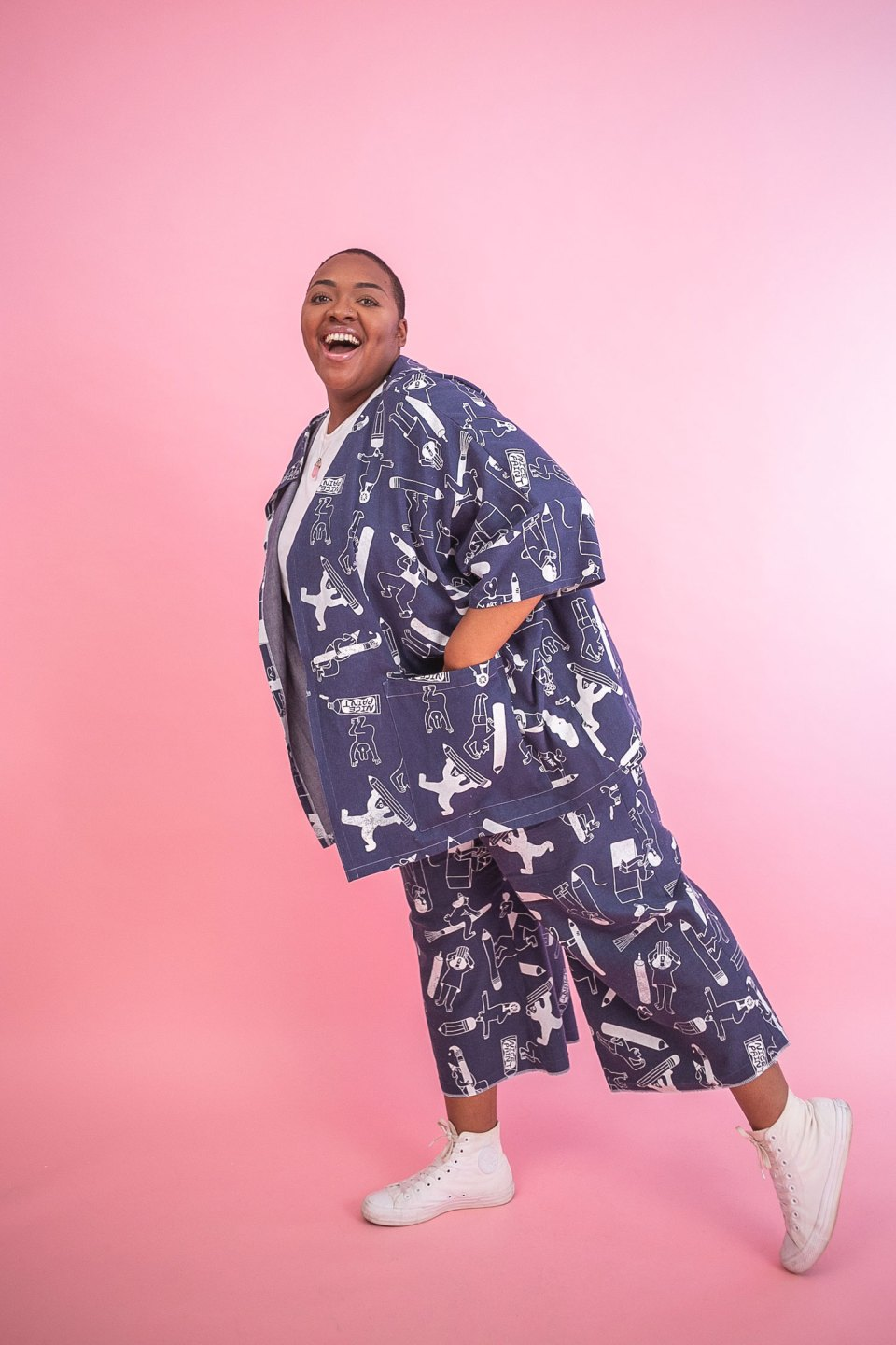 Nyome wears the YUK FUN Artist Suit in size XL