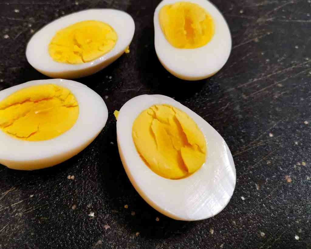 Perfectly cooked hard boiled eggs sliced in half