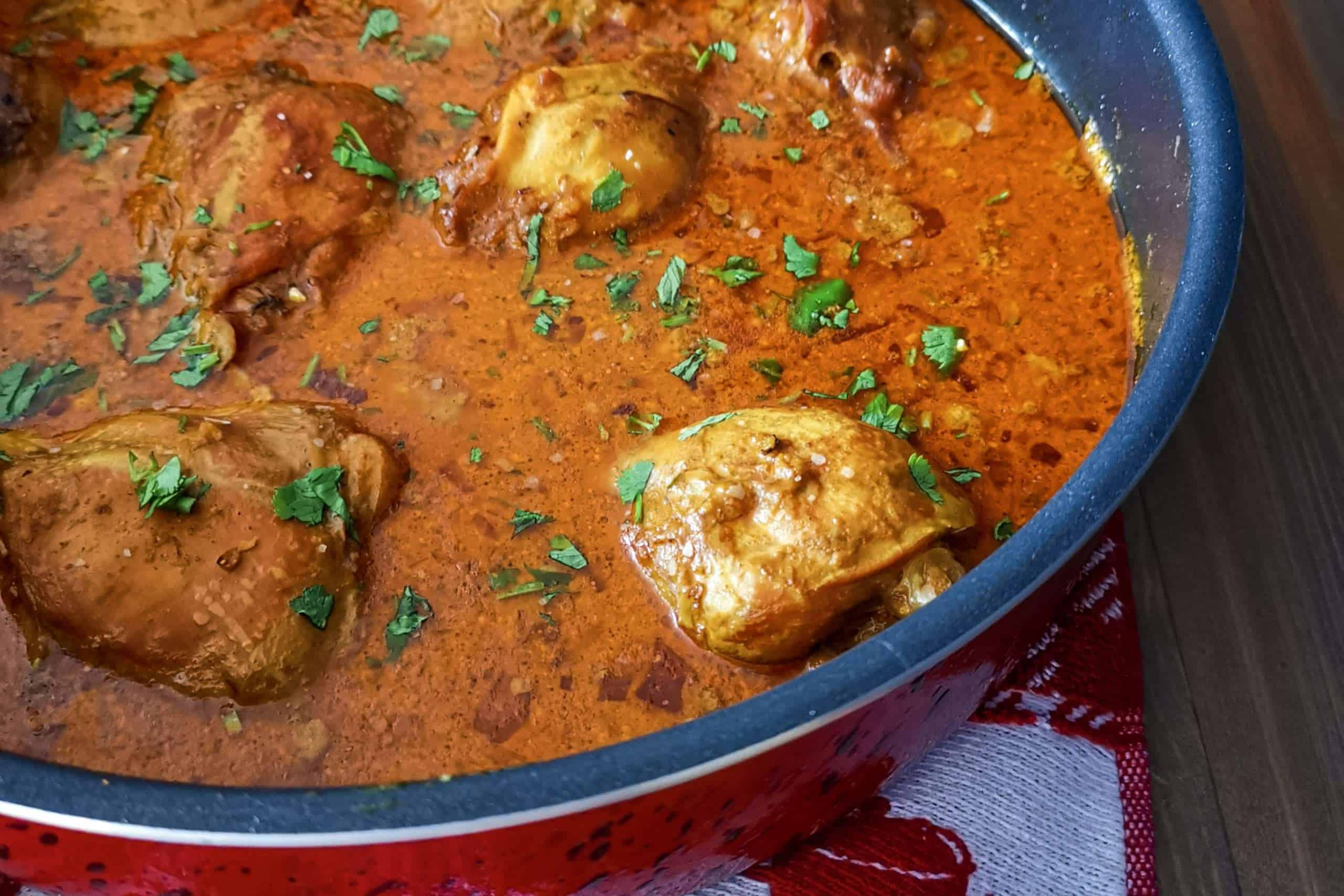 Keto friendly Indian chicken curry in a red pot