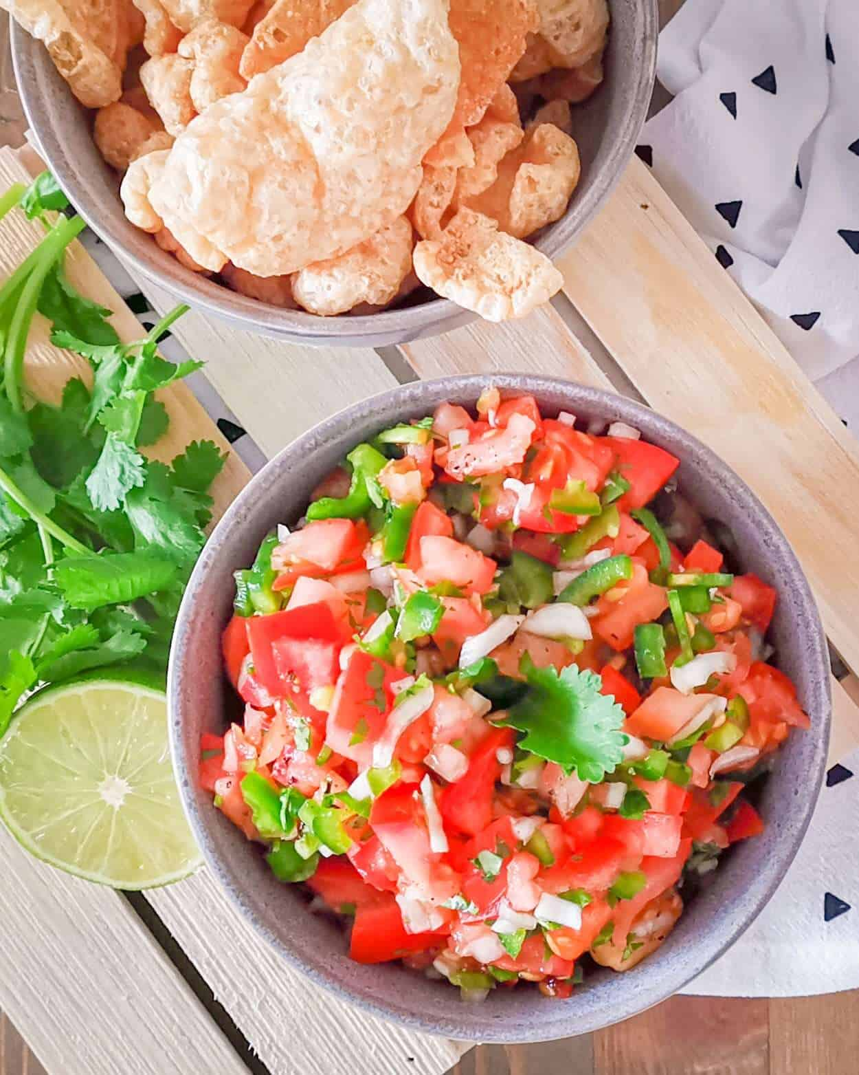 Keto Pico De gallo in a bowl with pork rinds for dipping