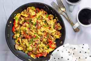 Cheesy keto protein scramble from above with coffee on the side.
