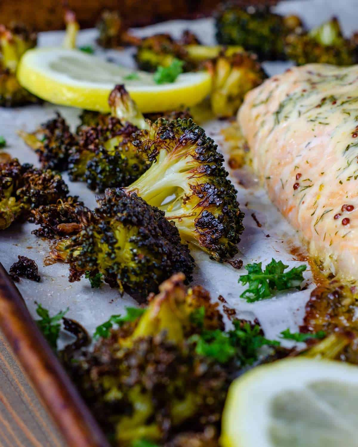 Crispy oven roasted broccoli with salmon on a pan