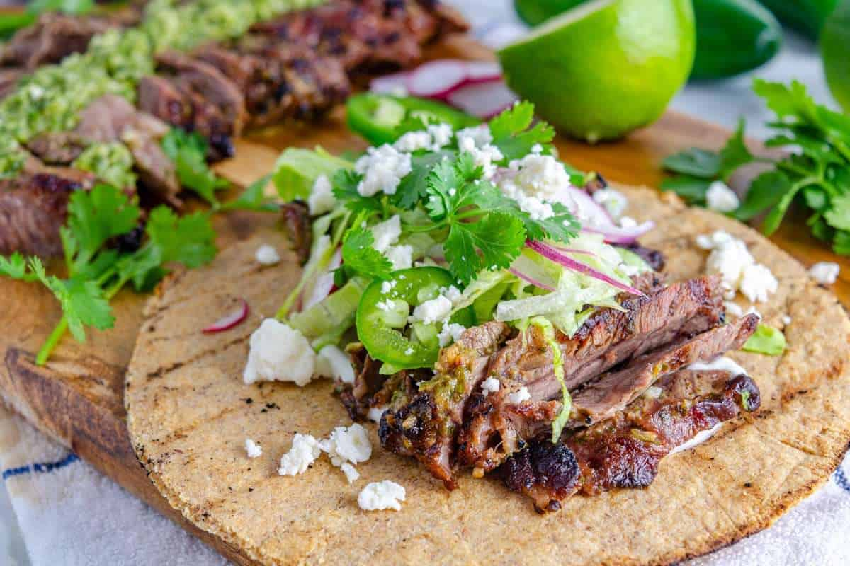 Grilled low carb tortillas topped with chimichurri steak