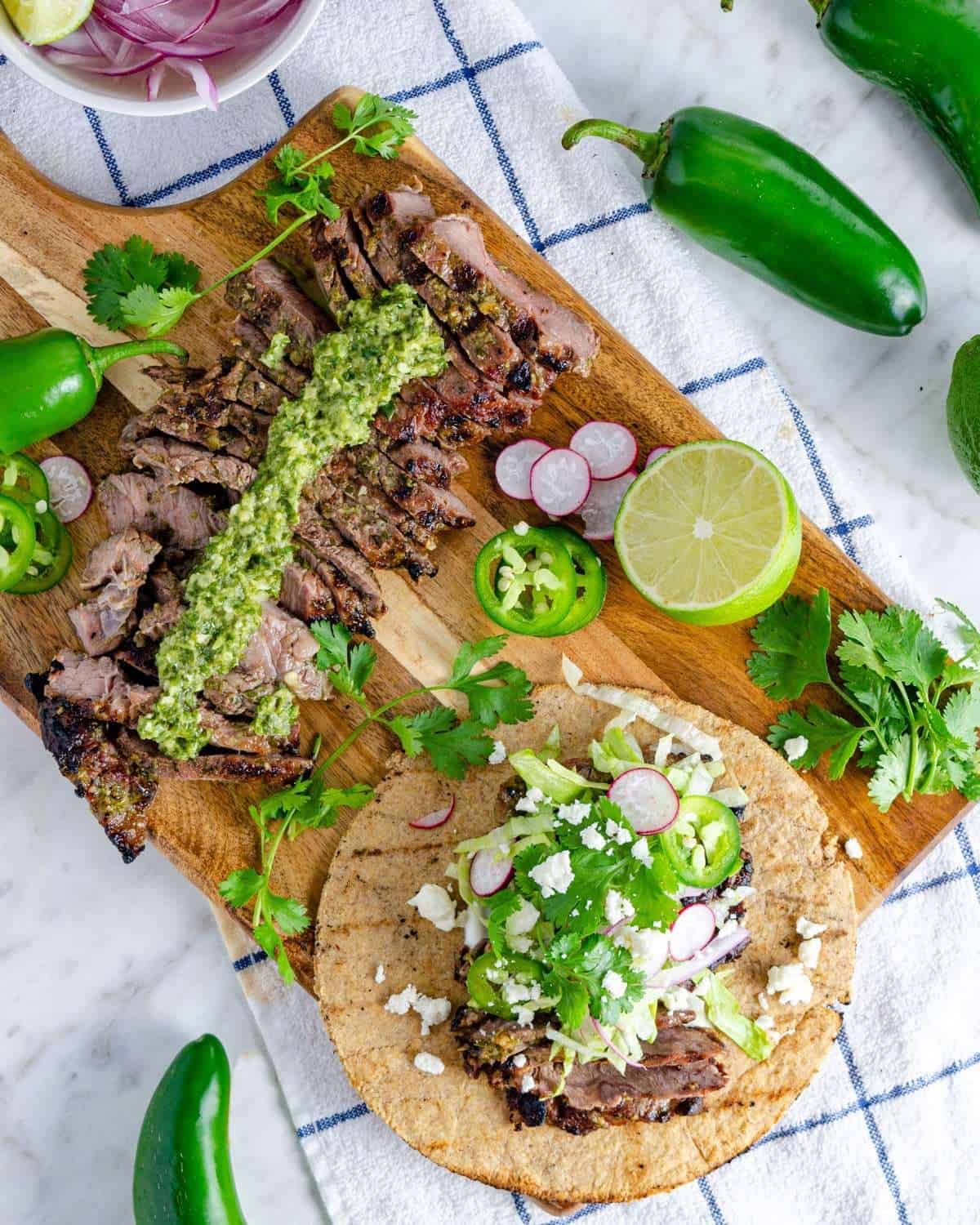 A platter of chimichurri steal fajitas on a low carb tortilla from above
