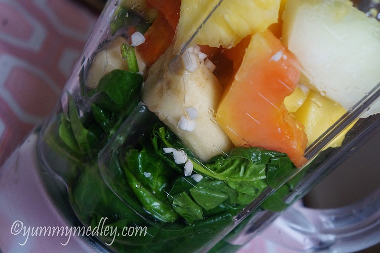 Tropical Island Green Smoothie - smoothie ingredients in a blender