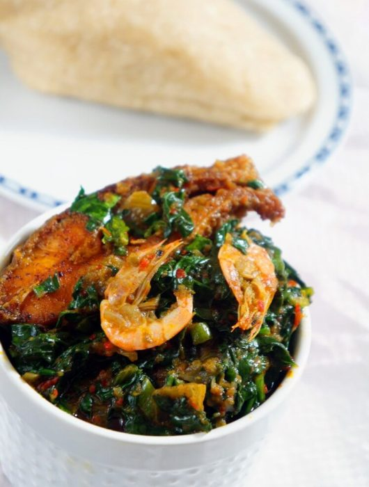 Efo riro a Nigerian spinach stew or vegetable soup served with seafood