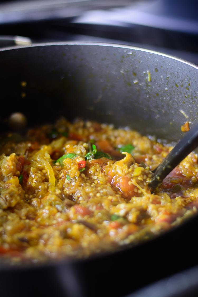garden egg stew stirred in pot