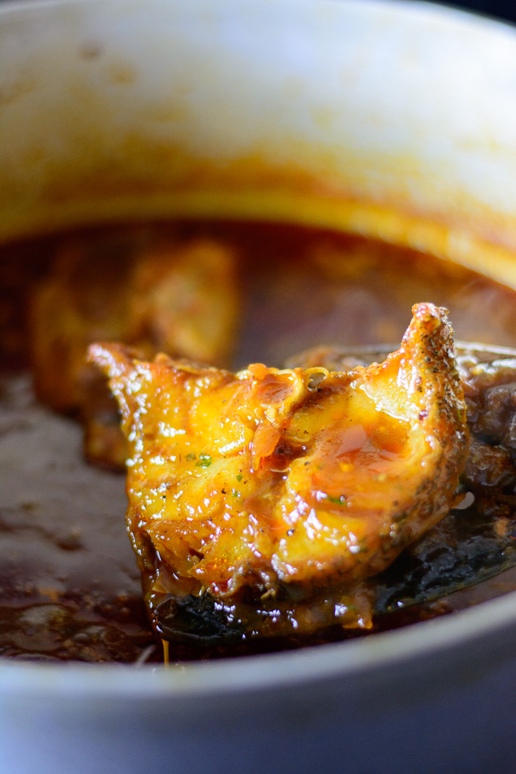 thieboudienne: removing fish from tomato sauce