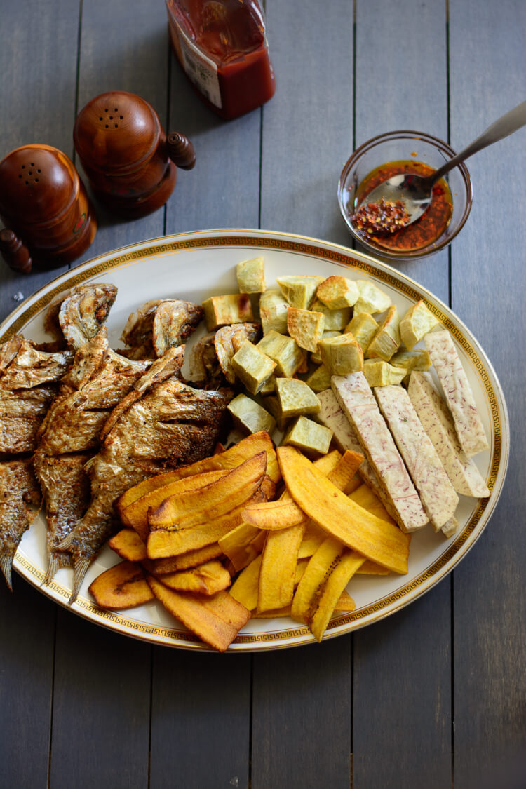 Nigerian fried fish with fried plantain, cocoyam and sweet potato